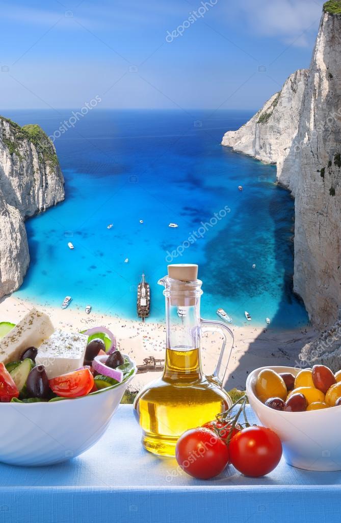 Navagio beach with Greek salad in Zakynthos, Greece