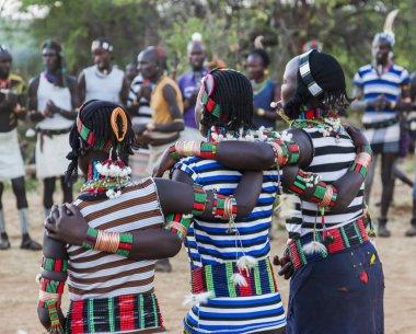 Boys and girls at the traditional evangaty ceremony. Turmi, Ethiopia.