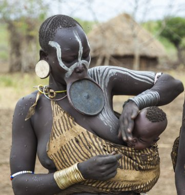 Woman from Mursi tribe in Mirobey village. Mago National Park. Omo Valley. Ethiopia.