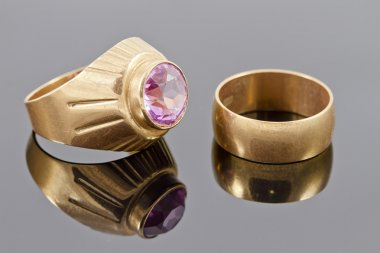 Gold ring with a precious stone and old broad engagement ring