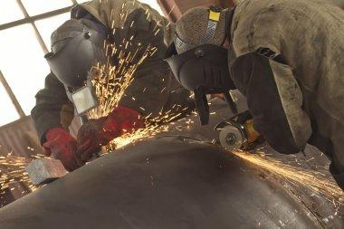 Welders weld multi-pass weld of the shell of the heat exchanger