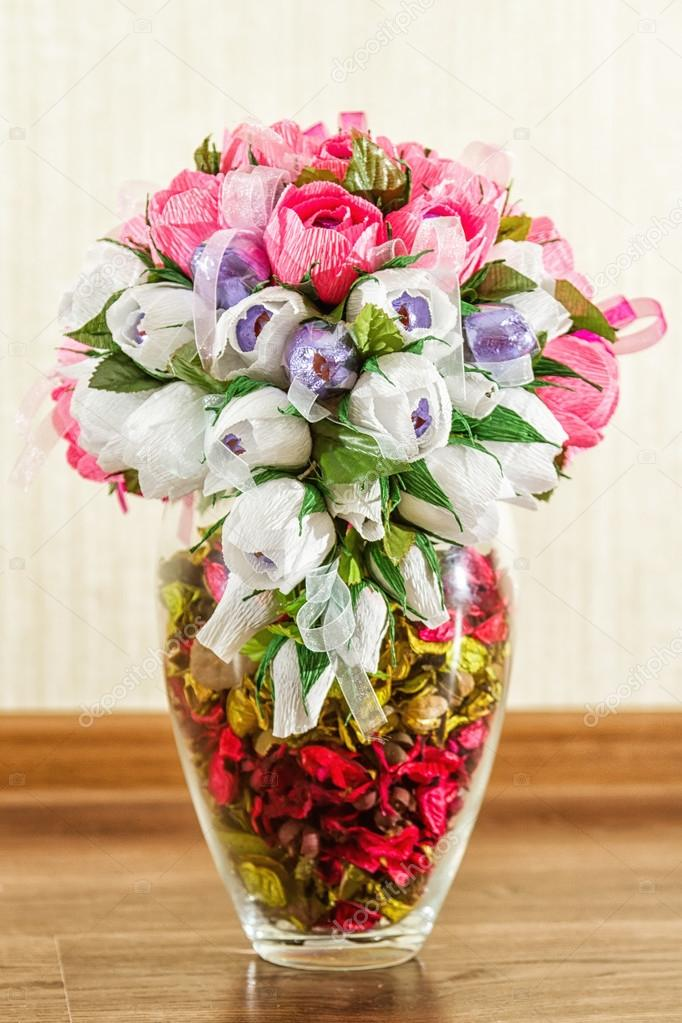 Beautiful candy bouquet in a vase with rose petals — Stock Photo ...