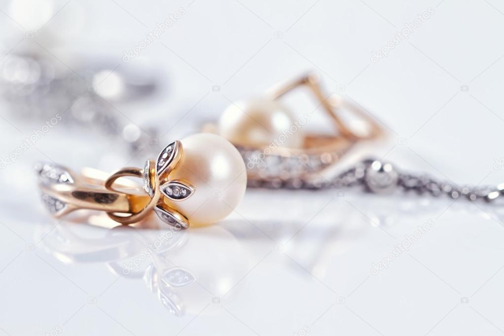 Beautiful gold earring with pearl — Stock Photo © shinobi #92874580