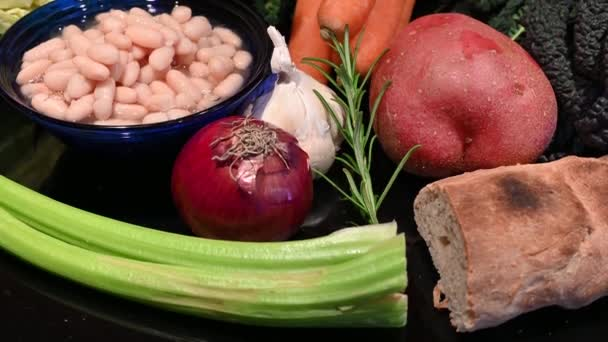 Close up shot on the ingredients for the famous Tuscan soup, called ribollita. Concept of healthy and genuine nutrition with fresh and natural ingredients. Tilt movement.