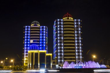 Buildings with night illumination in the square Minutka in Grozny