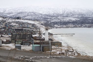MAGADAN, RUSSIA - DECEMBER 22: Old Soviet barracks on the shores of the Sea of Okhotsk in Magadan on December 22, 2014 in Magadan.