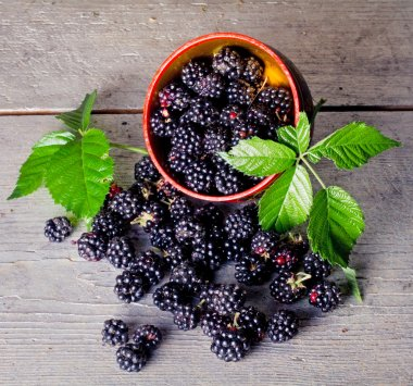 Sweet blackberries on an old wooden table