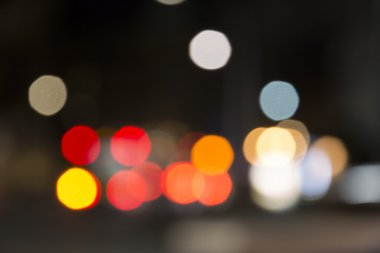 Defocused night traffic lights, blurred abstract background
