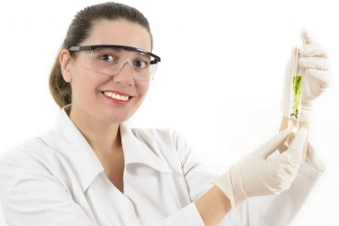 Woman Studying Plants in Laboratory