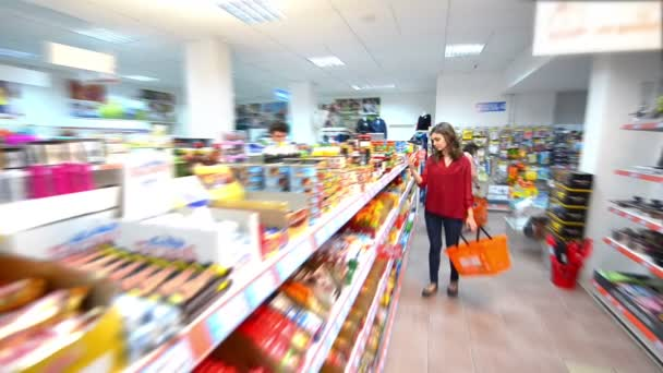 Customers choosing products in supermarket