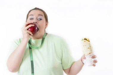 Corpulent Woman Struggling to Eat Healthy