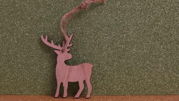 Wooden Christmas decoration, deer on Golden defocused glitter background