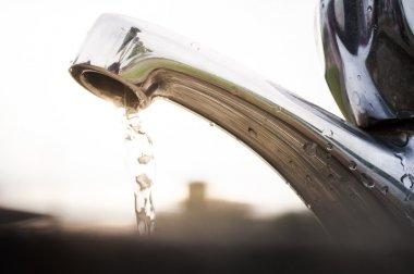 Open outdoor faucet