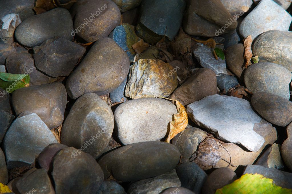 Texture, background. pebbles. a small stone made smooth and round by the action of water or sand.