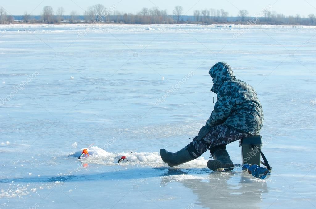 River flood fishermen. Torn river ice fishermen. River with the