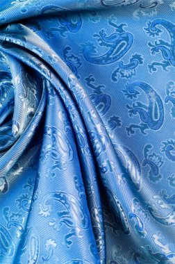 The texture of the silk fabric. Dark blue. With a picture of cuc