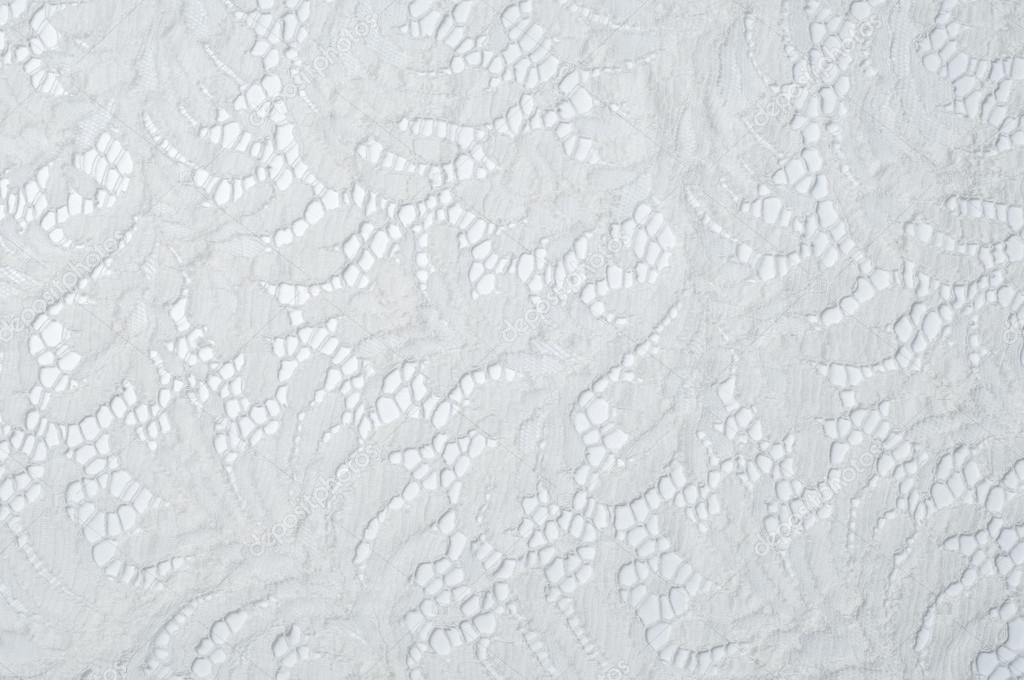 tela del cordón de textura. encaje en el estudio de fondo blanco ...