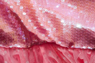 The texture of fabric lace with sequins on fabric background. Ma