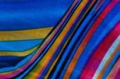Fotografie Fabric silk texture brown, blue, white, yellow.  Photography Studio