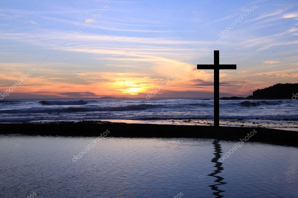 Sunset cross on the beach