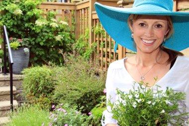 Lady gardener in the garden.