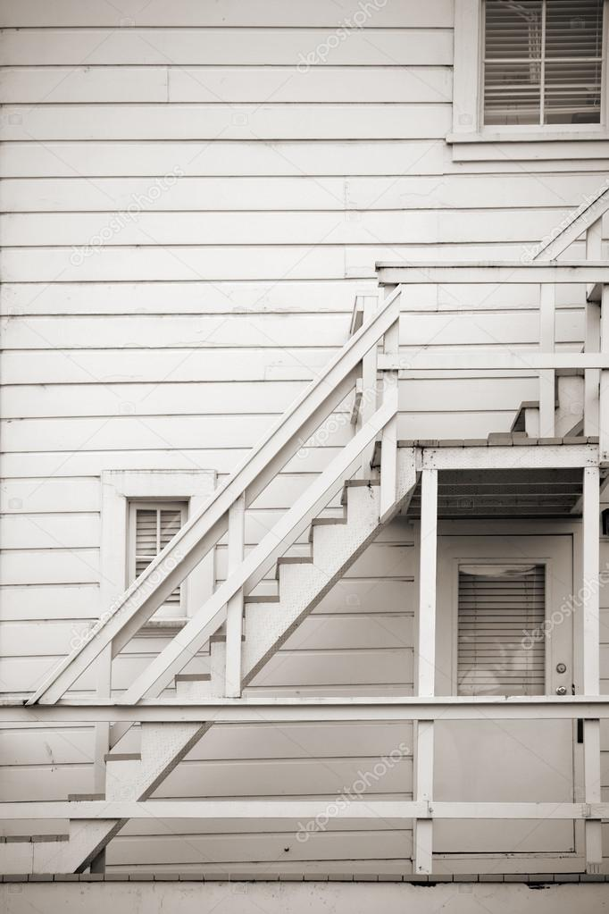 A Wooden Outside Staircase On A House With Boards Cladding. U2014 Photo By  Ginton