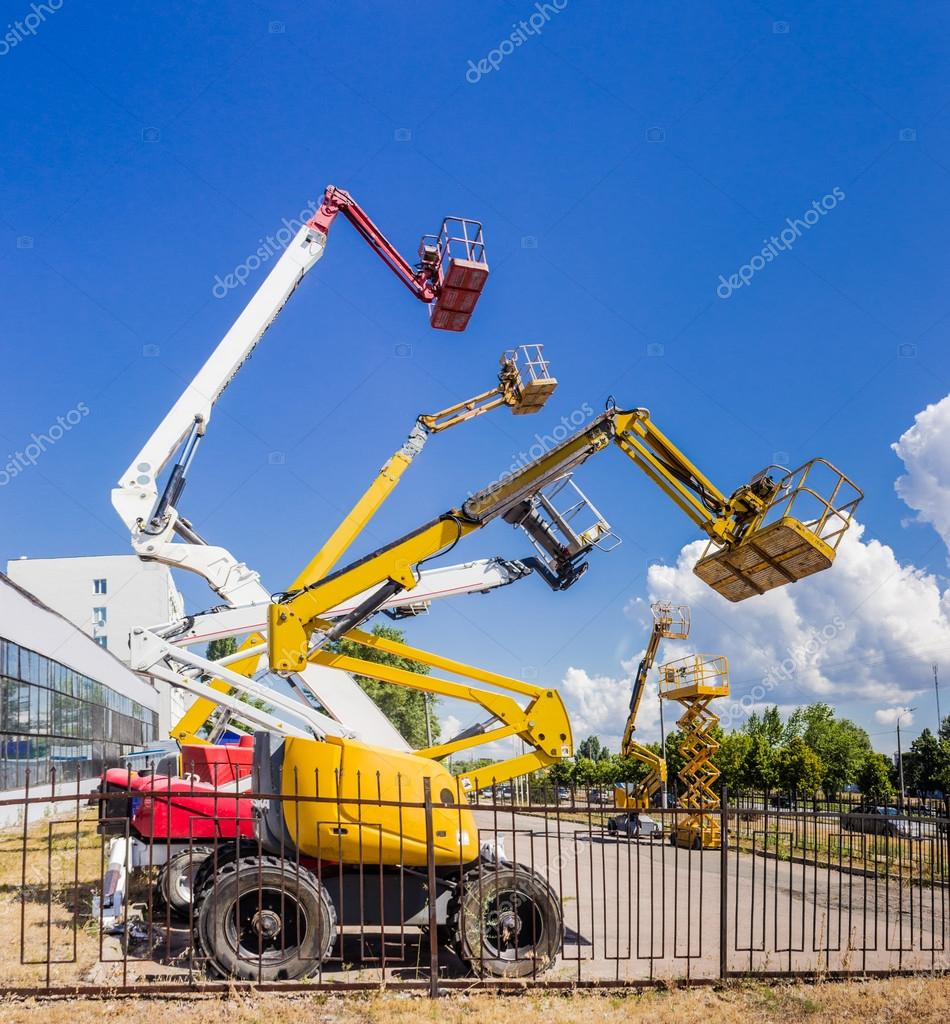 Several various self propelled articulated boom lift and scissor
