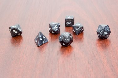 Specialized polyhedral dice for role-playing games on wooden sur