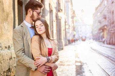 couple posing on streets of Europe
