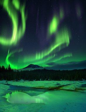 Aurora borealis over frozen lake