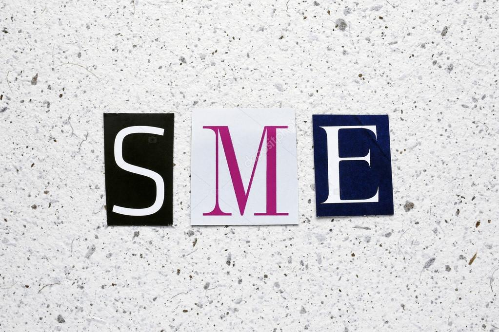 ee6b97729f6 SME (Small Medium Enterprises) acronym cut from newspaper on white handmade  paper texture —
