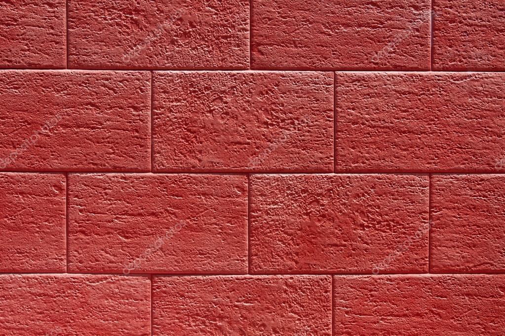 red stone wall texture or background � stock photo