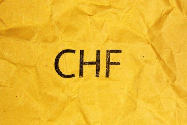 Symbol of swiss franc CHF on paper