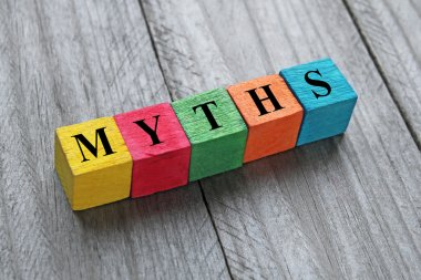 word myths on colorful wooden cubes