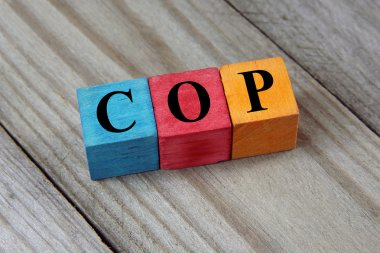 COP (Colombia Peso) sign on colorful wooden cubes