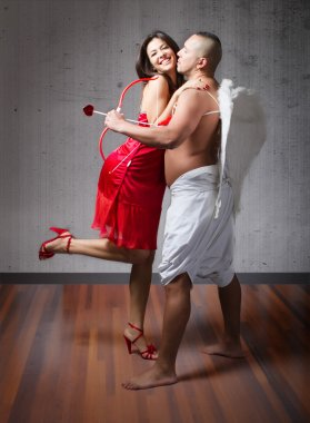 Cupid with nice girl in red dress