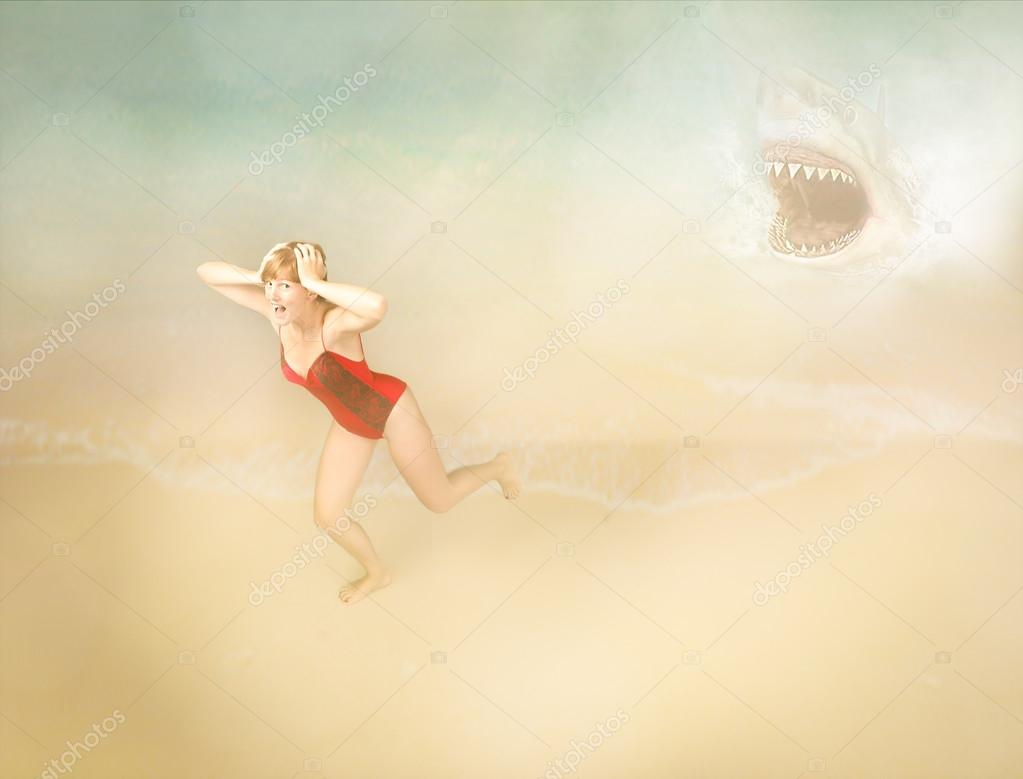 Girl on the beach during shark attack
