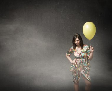 Young woman with balloon in hand