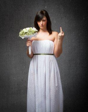 Sad bride showing a finger