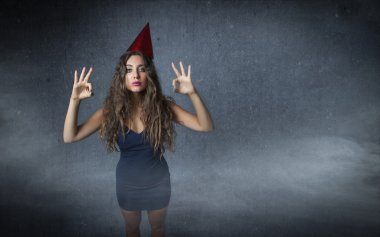 Woman wearing holiday hat