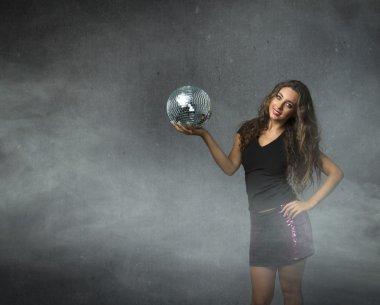 Girl with disco ball on hand