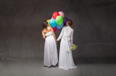 Brides holding balloons