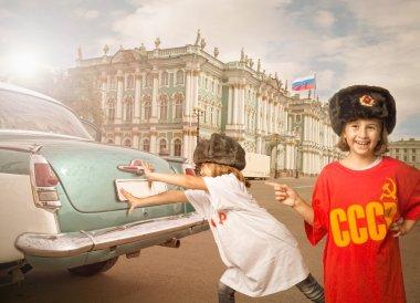 children pushing car in russian hermitage