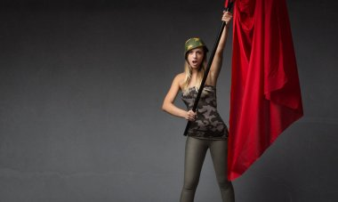 Military woman with red flag on hand