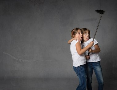 sisters taking selfie with camera