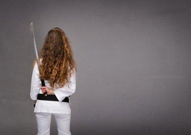 ninja back side with sword