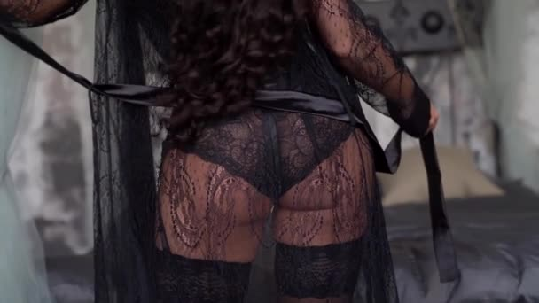 close-up of the ass of a brunette woman who poses in the Studio. Shes wearing sexy underwear and a lace Cape.