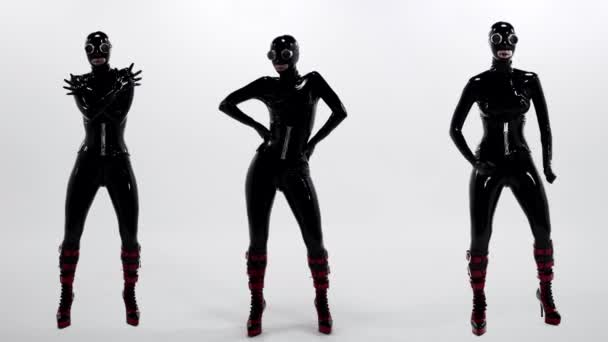 three sexual women are dancing, wearing erotical latex suit for roleplaying in bdsm theme