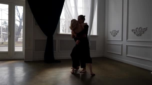 contemporary choreography, two young dancers are rehearsing in dance hall, love and passion