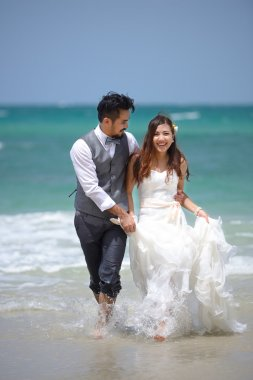 happiness and romantic scene of love just married couple walking